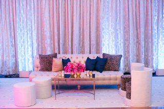 dancing-ballroom-wedding-space-with-tufted-sofa-blue-pillow-leopard-print-pillows