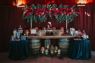 wedding-sweets-table-dark-moody-colors-wine-barrel-as-table-support