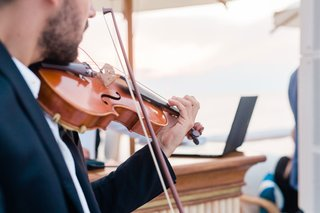 close-up-of-violin-being-played-during-outdoor-weddin