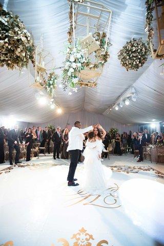heidi-mueller-and-demarco-murray-wedding-first-dance-with-daughter-savanna-on-custom-dance-floor