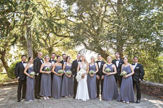 wedding-guests-bridesmaids-in-mismatched-purple-grey-gown-groomsmen-in-tuxedos