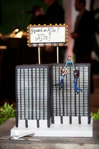 grooms-cake-funny-creative-cake-topper-building-groom-saving-bride-or-howard-stern