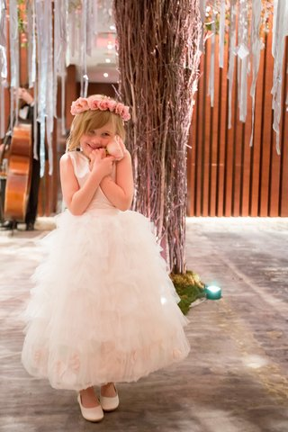 flower-girl-grasping-pink-rose-flower-crown-fluffy-gown-new-york-city-cute-precious-happy