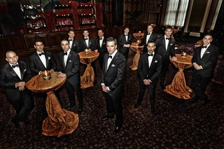 groom-with-groomsmen-at-copper-cocktail-tables