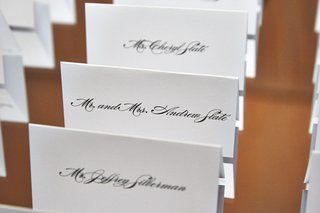 white-seating-cards-with-black-script-font-names