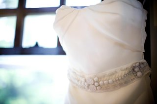 white-beaded-belt-on-strapless-gown