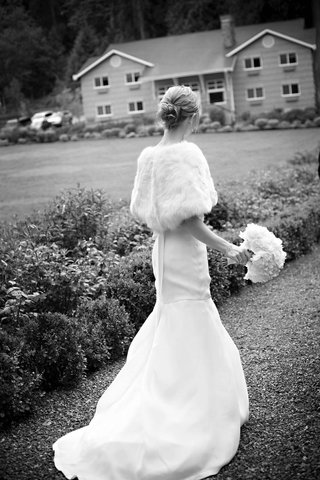 black-and-white-bride-wearing-fit-and-flare-gown-and-fur-wrap