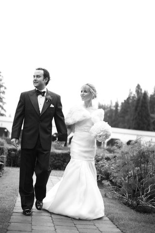 black-and-white-bride-and-groom-walking-to-wedding