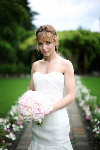bride-with-strapless-gown-pink-bouquet-and-updo