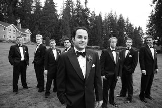 groom-and-groomsmen-in-field
