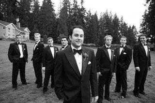groom-and-groomsmen-in-field