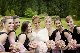 bridesmaids-and-bride-hold-bouquets