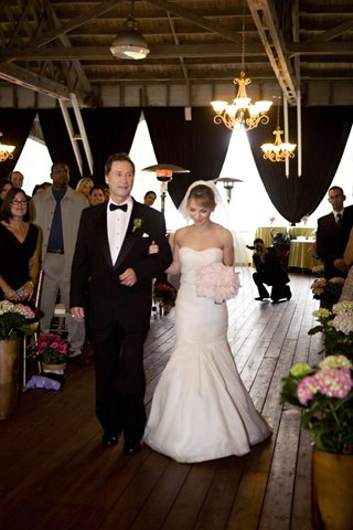 the-bride-walks-down-the-aisle-with-her-dad