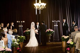 ceremony-with-candles-pink-flowers-and-brown-drapery