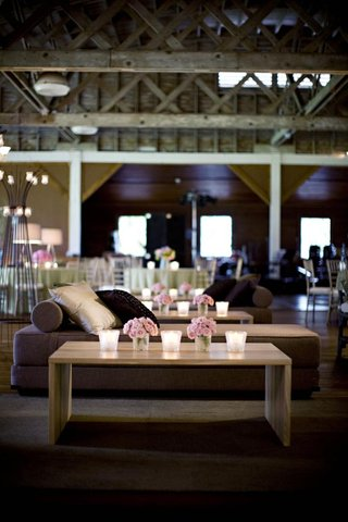 couches-and-coffee-table-in-barn-with-wooden-beam-ceiling