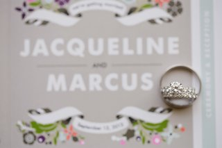 solitaire-engagement-ring-on-top-of-wedding-invite
