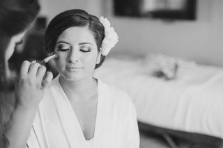 black-and-white-photo-of-makeup-artist-applying-blush-to-bride