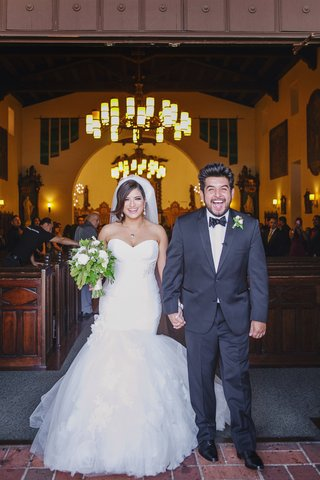 bride-and-groom-ecstatic-as-they-leave-church-ceremony