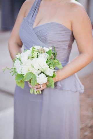 bridesmaid-in-purple-dress-holding-white-and-green-bouquet