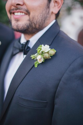 groom-wearing-natural-foliage-on-tuxedo-lapel