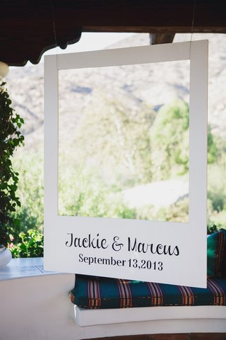 large-polaroid-picture-cut-out-with-bride-and-grooms-names-and-wedding-date