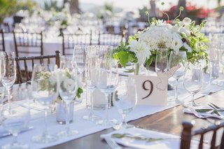 wood-table-with-white-runner-and-brown-table-number