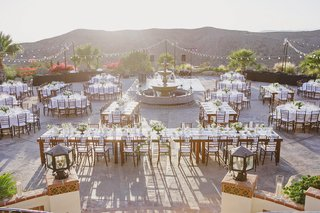 reception-tables-around-a-fountain-with-mountain-views