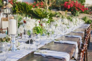 wood-reception-table-with-white-runner-and-natural-centerpieces