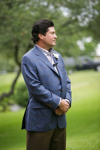 groom-in-a-plaid-blazer-patterned-shirt-espresso-pants-and-gardenia-boutonniere
