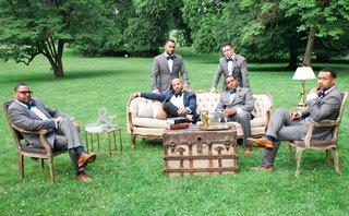 groom-in-ralph-lauren-brocade-blazer-groomsmen-in-macys-suits-outdoor-lounge-area