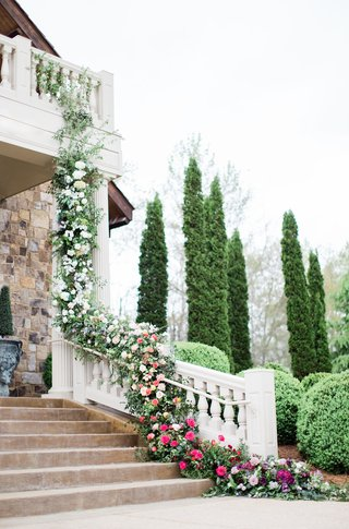 2400-on-the-river-wedding-garland-of-flowers-and-greenery-trails-from-balcony-down-bannister