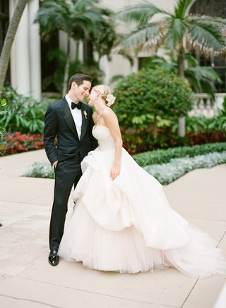 man-in-fitted-tuxedo-and-woman-in-princess-ball-gown