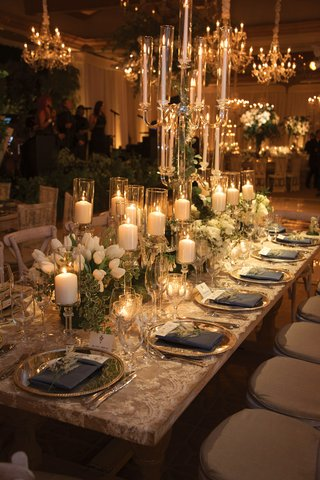 wedding-reception-table-lace-linen-candelabra-pillar-candles-on-crystal-stands