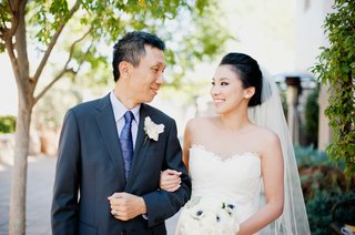bride-in-romona-keveza-looks-to-father-before-going-down-the-aisle