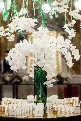 wedding-reception-in-germany-hotel-venue-white-orchid-greenery-overhead-vase-die-cut-cards