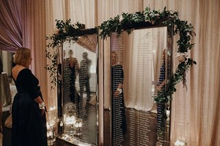 suzanna-villarreal-and-alex-wood-la-dodgers-wedding-seating-chart-mirror-with-etched-names-garland