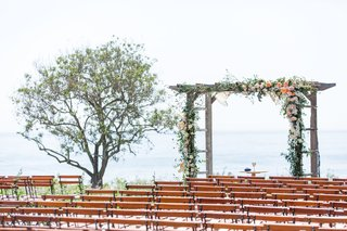 wedding-ceremony-wood-chairs-wood-arbor-greenery-rustic-chic-ocean-view-ceremony