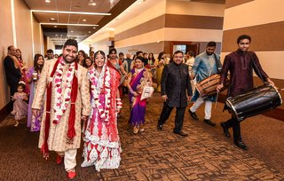 indian-newlyweds-celebrate-with-friends-and-family-after-wedding