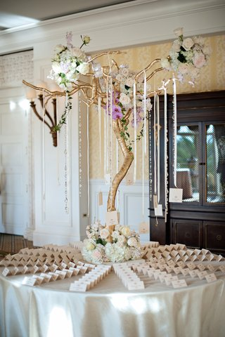 round-table-with-seating-cards-and-crystals-hanging-from-tree
