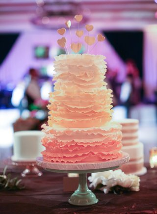 three-layer-wedding-cake-with-ruffles-and-heart-toppers