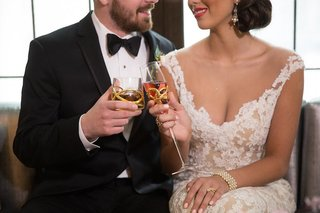 bride-and-groom-toast-with-gold-swirl-tumbler-and-champagne-flute