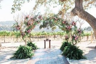 pitch-perfect-stars-anna-camp-skylar-astin-wedding-chuppah-trees-pink-blush-flowers-vineyard-rustic