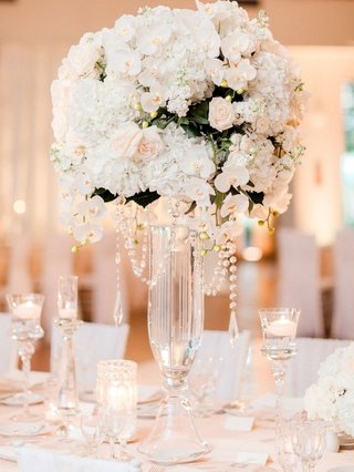 wedding-reception-candles-floating-tall-glass-vases-with-white-orchid-hydrangea-rose-greenery-flower