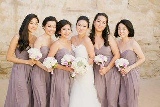 bride-in-romona-keveza-strapless-wedding-dress-bridesmaids-in-mauve-chiffon-strapless-dresses