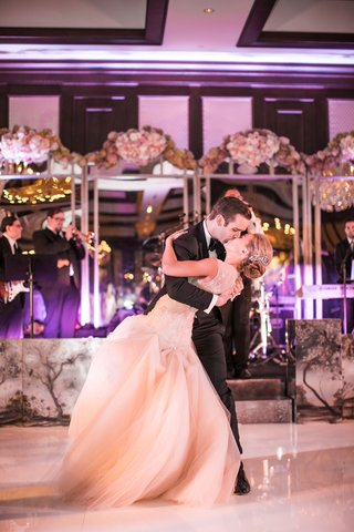 bride-and-groom-kiss-during-first-dance-to-you-are-the-best-thing-by-ray-lamontagne