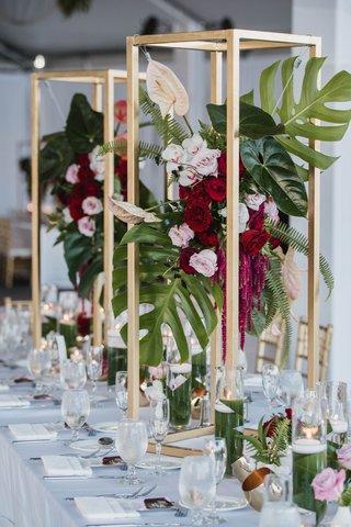 golden-3d-frame-encasing-display-of-split-leaves-lanceleaf-blossoms-orchids