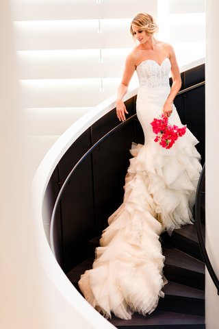 bride-in-strapless-lazaro-corset-dress-with-long-ruffled-train