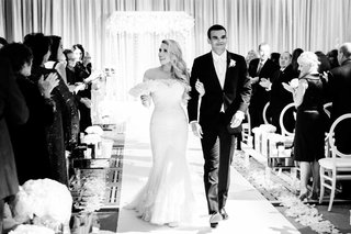 black-and-white-wedding-photo-ceremony-recessional-bride-in-formfitting-illusion-gown-groom-in-white