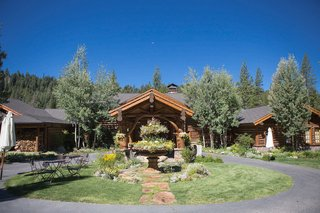 log-cabin-house-with-circular-driveway-and-lawn