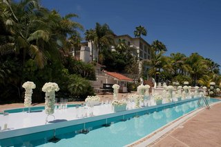 joanna-krupa-wedding-ceremony-aisle-over-pool